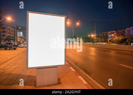Blank Billboard on City Street at Night - Stock Photo