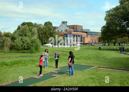Women & Children Play Mini Golf or Crazy Golf on the Recreation Ground opposite the Royal Shakespeare Theatre Stratford-upon-Avon England - Stock Photo