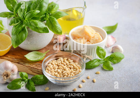 Ingredients for making green pesto sauce. - Stock Photo