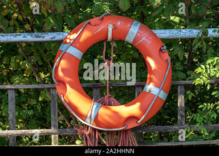 Life saving buoy designed to be thrown to a person in the water, to provide buoyancy and prevent drowning - Stock Photo