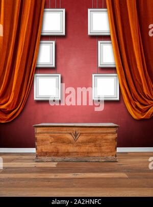Modern interior with old wooden chest against red textured wall - Stock Photo
