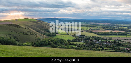 Landscape panoramic view from Devil's Dyke car park of hills & villages of the South Downs in the Mid Sussex district of West Sussex, England, UK. - Stock Photo