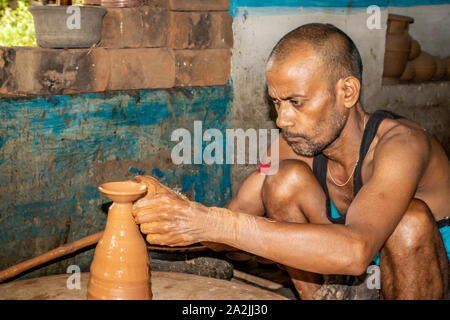 SIJHORA,INDIA,SEPTEMBER - 17, 2019 :Indian potter making oil lamps for Diwali festival. - Stock Photo
