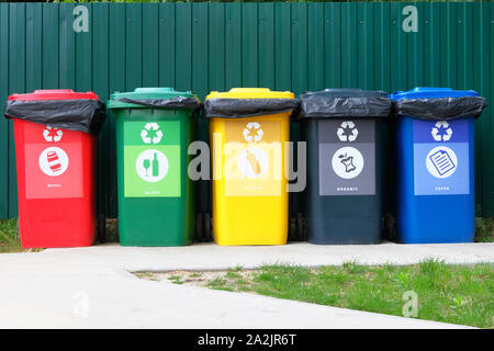 Separate garbage collection. Waste recycling concept. Containers for metal, glass, paper, organics, plastic for further processing of garbage. - Stock Photo