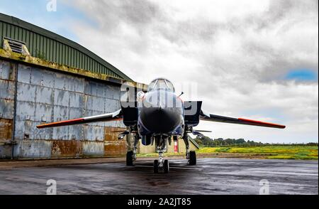 ZA326 Panavia Tornado GR1 in royal aircraft est colours or raspberry ripple as it is affectionately known in front of a hangar under moody skies - Stock Photo