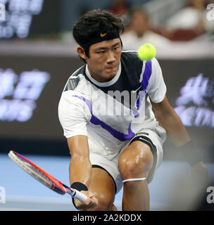 Chinese professional tennis player Zhang Zhizhen competes against Austrian professional tennis player Dominic Thiem at the second round of 2019 China Open (Tennis), in Beijing, China, 2 October 2019. Chinese professional tennis player Zhang Zhizhen was defeated by Austrian professional tennis player Dominic Thiem with 0-2 at the second round of 2019 China Open (Tennis), in Beijing, China, 2 October 2019. - Stock Photo