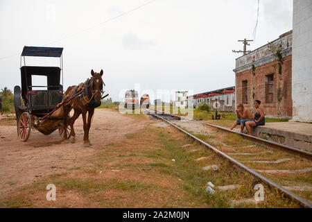 Cuba Cardenas Railwaystation people living in old trains by lack of houses. Horse and carriage 9-7-2018 foto Jaco Klamer - Stock Photo
