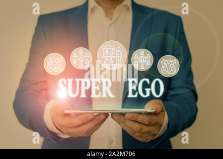Writing note showing Super Ego. Business concept for The I or self of any demonstrating that is empowering his whole soul Male wear formal work suit p - Stock Photo