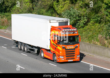 heavy bulk Haulage delivery trucks, haulage, lorry, transportation, truck, cargo, Scania S series vehicle, delivery, transport, industry, supply chain freight, on the M6 at Lancaster, UK - Stock Photo
