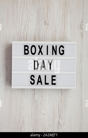 'Boxing day sale' words on a modern board on a white wooden background, top view. Overhead, from above, flat lay. - Stock Photo