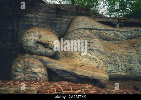 Reclining Buddha statue, Gal Vihara at Polonnaruwa, sri lanka - Stock Photo