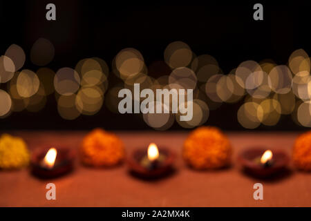 Diwali - an Indian festival of lights which is now celebrated all over the world. An abstract blurred background picture of diya oil lamp with copy sp - Stock Photo