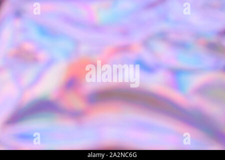 Holographic defocused wrinkled abstract foil texture. Glittering blurred surface pack. - Stock Photo