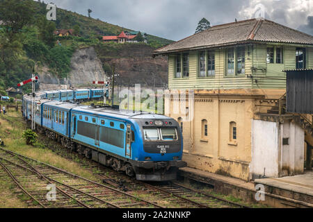 A passenger train departs Nanu Oya Station on a stormy day in the Central Province of Sri Lanka. - Stock Photo