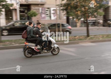 Pristina road with passing motor bike. Speed of Kosovo - Stock Photo