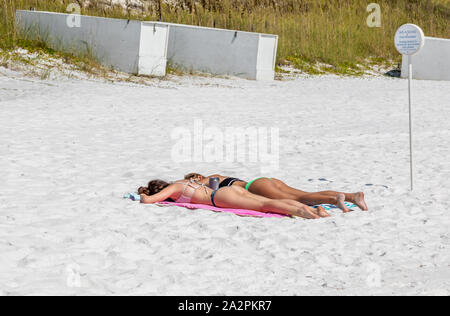 two teenage girls sunbathing in Seaside, Florida - Stock Photo