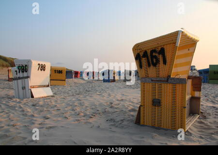 Beach chairs at the sandy beach of Langeoog (Germany) - Stock Photo