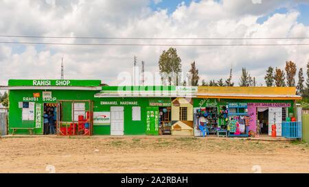 Nyeri-Nanyuki road, Kenya – June 20th, 2019: Street photograph of typical Kenyan small convenience stores found on-side of the Nyeri – Nanyuki road (A - Stock Photo