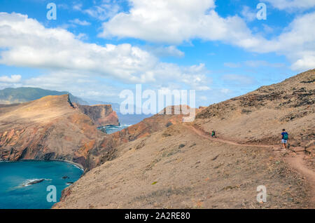 Stunning cliffs in Ponta de Sao Lourenco, Madeira Island, Portugal. The easternmost point of the island of Madeira, volcanic landscape by the Atlantic ocean. Hikers on a scenic hiking path. Trail. - Stock Photo
