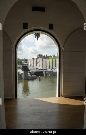 View on Oosterdock from Nederlands Scheepvaartmuseum (Netherlands Maritime Museum) in Amsterdam - Stock Photo