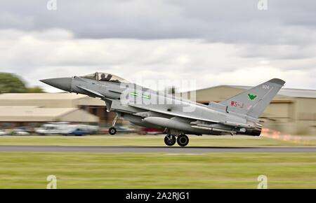 RAF Lossiemouth Aggressors 9 Eurofighter Typhoon performing at the 2019 Royal International Air Tattoo - Stock Photo