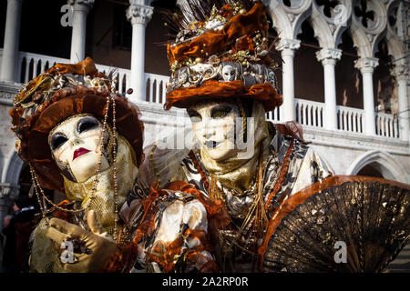 VENICE, ITALY - JUN 6, 2013: Costumed couple on the Piazza San Marco during Venice Carnival. - Stock Photo