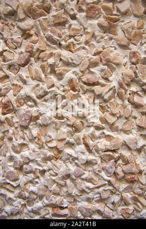 Close-up of a wall with stone mono layer mortar projected on the surface - Stock Photo