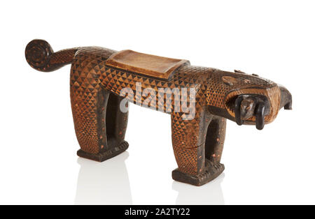 stool in the form of a leopard, Baule people, 20th century, wood, pigment, 18-1/2 x 14-3/4 x 12 in., African Art - Stock Photo