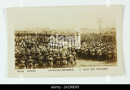 Cigarette Card - 'Unveiling Memorial 1st Australian Division', Official World War I Photograph, Magpie Cigarettes, circa 1922, No. 68 in the series of World War I cigarette cards produced by Magpie Cigarettes. The image is titled 'Unveiling Memorial 1st Australian Division'. It depicts the 1st Australian Division standing in a graveyard watching the unveiling of a memorial. The images on this series of cigarette cards are official World War I photographs which were displayed at the Australian War Museum, Exhibition - Stock Photo