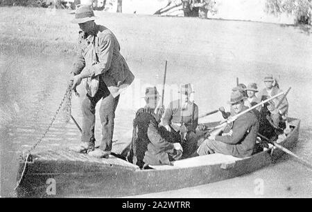 Negative - Merbein District, Victoria, circa 1925, A group of shooters in a boat on the Murray River. A man at the prow appears to be raising the anchor - Stock Photo