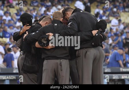 Los Angeles, United States. 03rd Oct, 2019. Umpires gather before the first game of the MLB National League Division Series between the Washington Nationals and the Los Angeles Dodgers at Dodger Stadium in Los Angeles, California on Thursday, October 3, 2019. Photo by Jim Ruymen/UPI Credit: UPI/Alamy Live News - Stock Photo