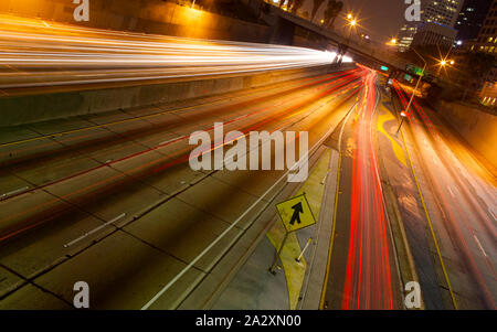 A long exposure of a freeway at night in the city. - Stock Photo