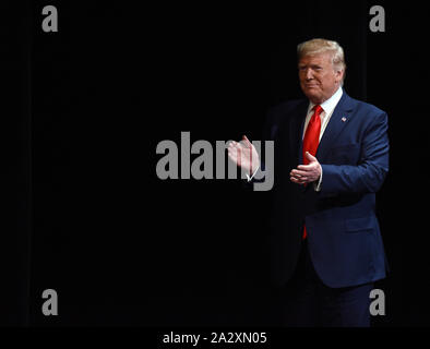 The Villages, United States. 03rd Oct, 2019. U.S. President Donald Trump looks claps his hands after giving remarks on his administration's health policy and signing an executive order regarding Medicare at the Sharon L. Morse Performing Arts Center on October 3, 2019 in The Villages, Florida. Credit: Paul Hennessy/Alamy Live News - Stock Photo