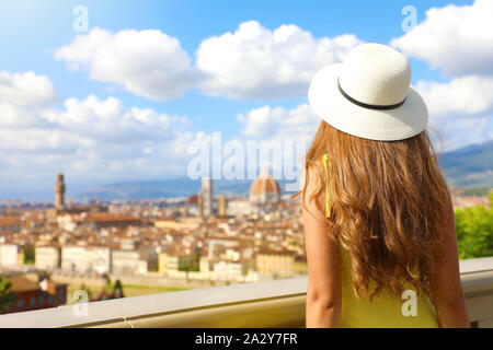 Tourism in Italy. Back view of young woman enjoying panoramic view of Florence city, Tuscany, Italy. - Stock Photo