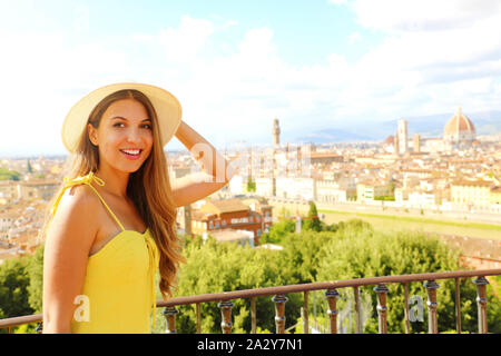 Happy cheerful tourist girl in Florence, Italy. Portrait of young woman visiting Italy. - Stock Photo