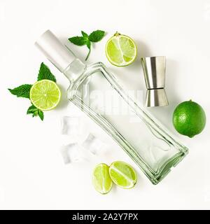 Mojito , flat lay with a bottle of rum, limes and mint on a white background. Concept: Alcohol Mojito Cocktail - Stock Photo