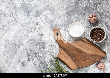 Spices, Herbs, Wooden Cutting board for cooking. Cutting board on grey concrete backdrop. Top view with copy space for text. Menu, recipe mock up, ban - Stock Photo
