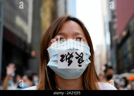 Hong Kong. 4 October 2019. Large peaceful march by thousands of pro-democracy supporters through Central business district of Hong Kong this afternoon. March was in protest against Chief Executive Carrie Lam's use of Emergency Powers to ban the wearing of masks during protests. Iain Masterton/Alamy Live News. - Stock Photo