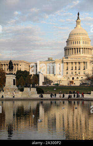 The Capitol Building and the Capitol Reflecting Pool at the eastern end of the National Mall in Washington, DC. - Stock Photo