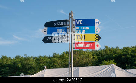 Crossroad signpost saying this way, that way, another way concept for lost, confusion or decisions - Stock Photo