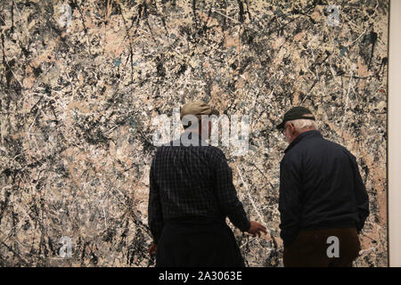 Visitors in front of the 'Number One (Lavender Mist)' 1950 painting by J. Pollock at the National Gallery of Art in Washington DC, USA - Stock Photo