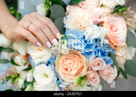 Bride showing off her beautiful boho flowers bouquet chic boho wedding magazines and websites, bohemian, fashion, florist and other related subjects - Stock Photo
