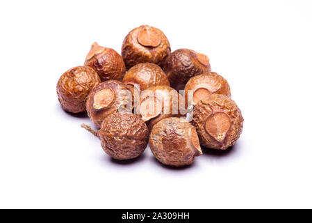 Group of soap nuts in isolated white background. - Stock Photo