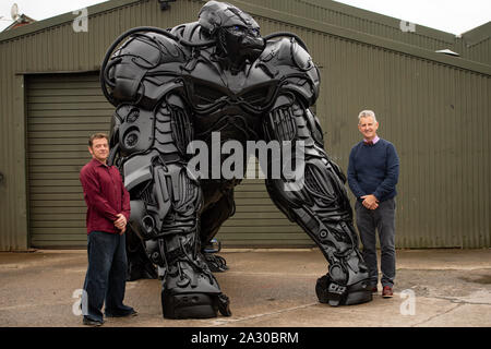 Sculptor Luke Kite, with Chairman of the British Ironworks Centre Clive Knowles (right), stands by his 12ft sculpture of a gorilla, entitled 'Gorilla Apocalypse', created entirely from scrap car bumpers and panels discarded from only the last decade, on display at the British Ironwork Centre in Oswestry, Shropshire. PA Photo. Picture date: Friday October 4, 2019. The sculpture, named 'Bumper Joe' during production, serves as a protest against the perceived negative effects the global car industry has on the planet. Photo credit should read: Jacob King/PA Wire - Stock Photo