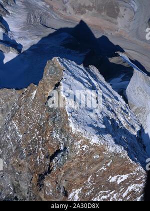 4478-METER-HIGH SUMMIT OF MATTERHORN / CERVINO (aerial view). Long ridge separating Italy in Breuil-Cervinia (rocky side) from Switzerland in Zermatt. - Stock Photo