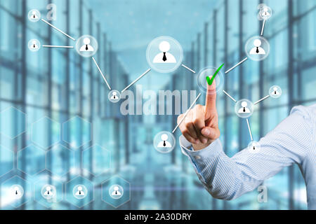 Businesswoman touching touch screen with her finger. Human resources recruitment and people networking concept - Stock Photo