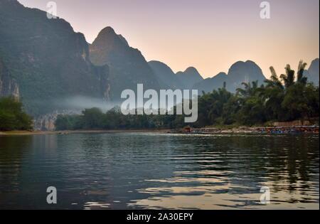Li river basin and mountains at dusk, Guangxi, China - Stock Photo