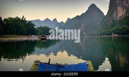 Li river basin and mountains at dusk from boat, Guangxi, China - Stock Photo