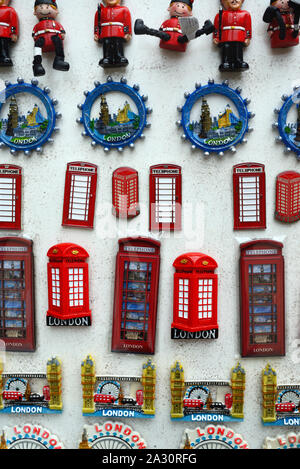 London Souvenir Fridge Magnets or Badges of English Icons including London Bridge & Red Telephone Boxes for Sale on Souvenir Stall London England UK - Stock Photo