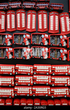 Red Buses & Red Telephone Boxes Souvenir Fridge Magnets on Sale in Gift Shop or Souvenir Stall London UK - Stock Photo